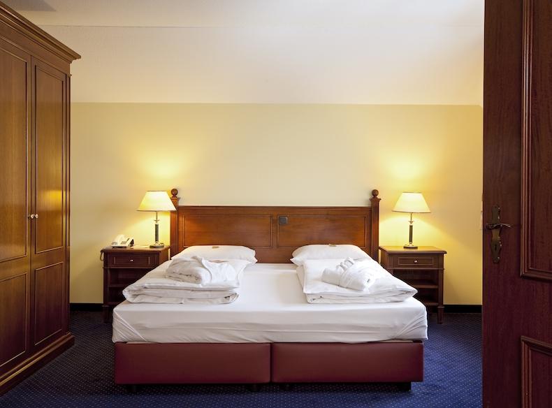 Bett im Dorint Marc Aurel Hotel - Komfort Zimmer